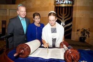Young woman reading the Torah at her bat mitzvah