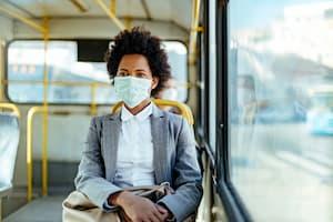 Woman wearing mask on shuttle